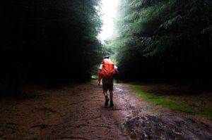 guy hiking in rain
