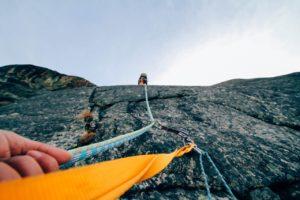 scaling rock face