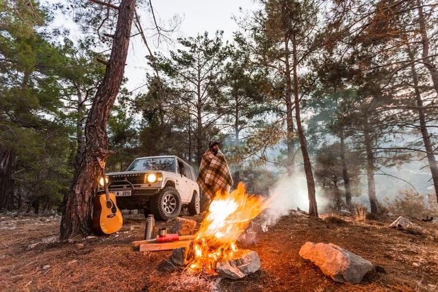 campfire smoke following guy